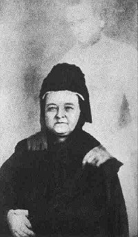 Spirit Photographer William H. Mumler supposedly took this famous photograph, purportedly showing Mary Todd Lincoln with the ghost of her husband, Abraham Lincoln. (From Wikipedia)